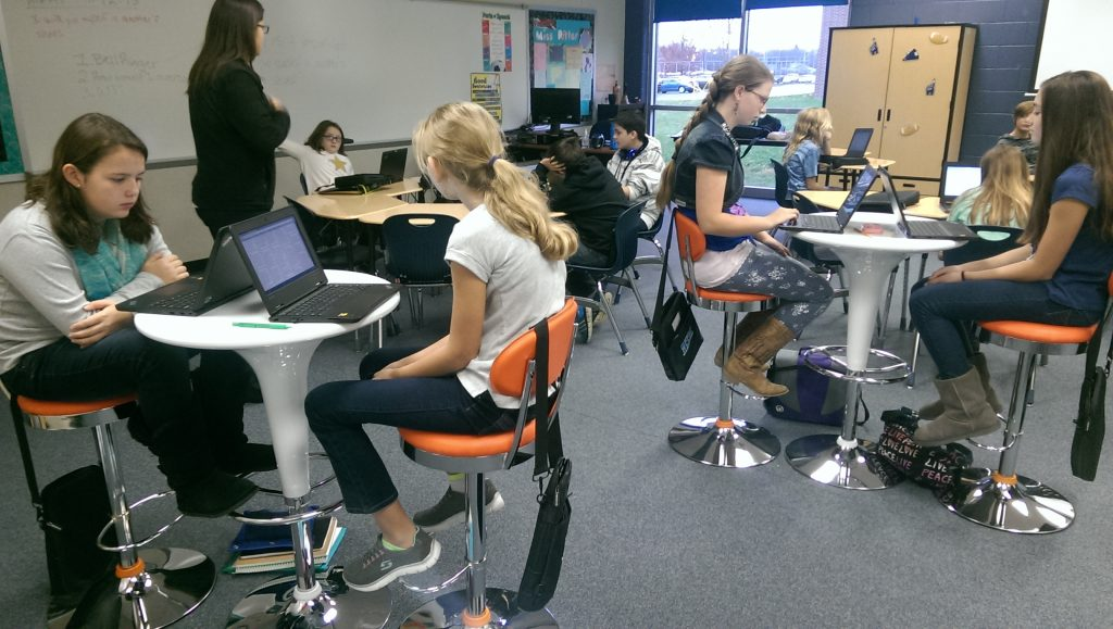 Students at Cascade Middle School test out new classroom furniture donated by Orange Leaf Frozen Yogurt. It's helped to update classroom design at the school -- an important aspect of learning. (Photo via Eric Sieferman)