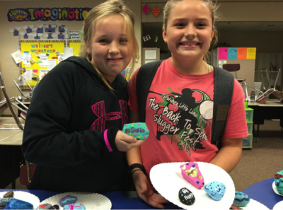 5th grade students created Happiness Rocks for a Growth Mindset Project. They placed the rocks around their school to be found in hopes of making others smile. (Photo courtesy of Kim Strobel)